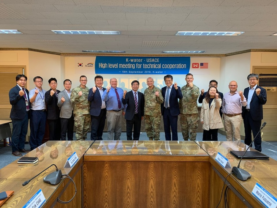 K-water Chief Research Officer Dr. Park, Jae Young (center), Maj. Gen. Anthony C. Funkhouser (center right) and senior leaders pose for a group photo.