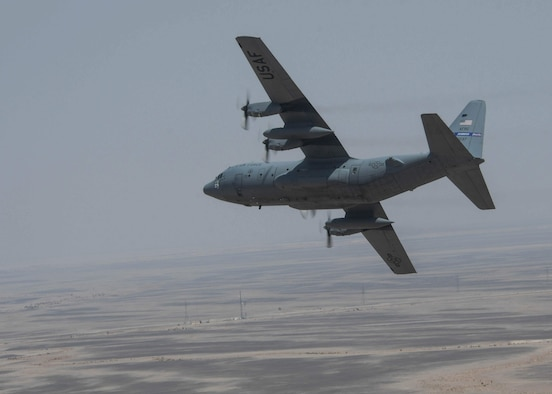 A C-130H3 from Dobbins Air Reserve Base, Ga., banks right as part of a controlled turn in a flight formation during Exercise Eager Lion on Sept. 1, 2019 in Jordan.
