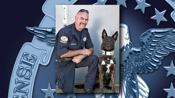 Jeff Finlay, chief of security and emergency management for Defense Logistics Agency Distribution Tobyhanna, Pennsylvania, poses with Kane, a human remains detection dog. Finlay serves on Pennsylvania Task Force One, one of the Federal Emergency Management Agency's 28 urban search and rescue teams, as well as several local, state and federal incident management teams that help emergency responders bring order to the chaos that follows an emergency. Courtesy photo