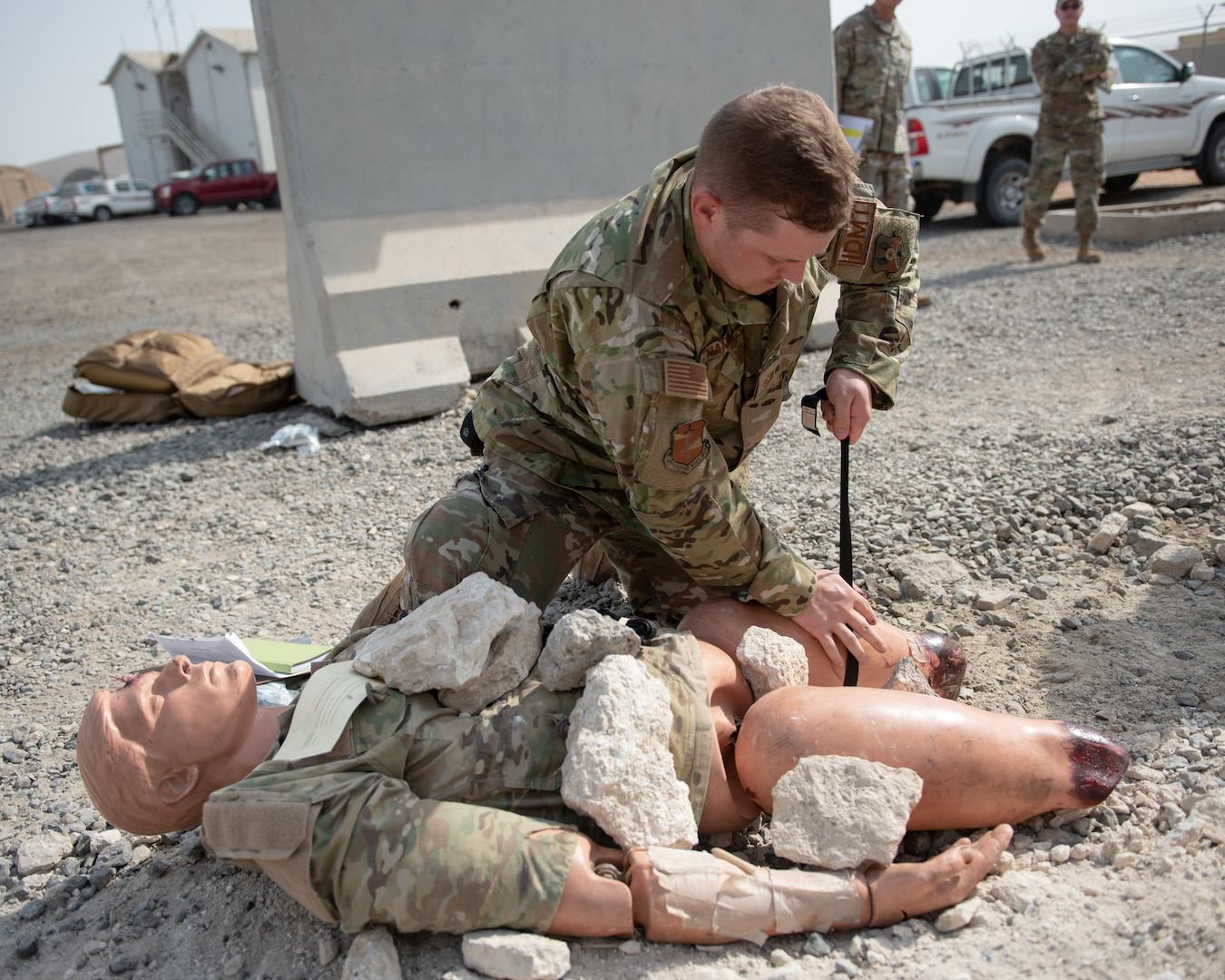 Tech. Sgt. Brett Randall, 380th Expeditionary Medical Group independent duty medical technician, applies a tourniquet during a large first responder exercise Sept. 24, 2019, at Al Dhafra Air Base, United Arab Emirates. A variety of agencies including medics, firefighters and security forces defenders participated in the exercise to test their readiness, knowledge of emergency procedures and interagency cooperation amongst the wing's first responders. (U.S. Air Force photo by Staff Sgt. Chris Thornbury)