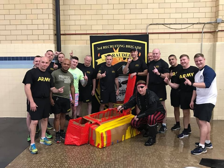 """The command teams of the Chicago Recruiting Battalion pose for a photo following the """"Boat Wars"""" competition at Gammon Physical Fitness Center, Fort Knox, Kentucky, Sept. 22. Chicago Recruiting Battalion won first place. The competition was part of a three-day training forum hosted by 3rd Recruiting Brigade to prepare for successful support to the Army's 2020 recruiting goal."""