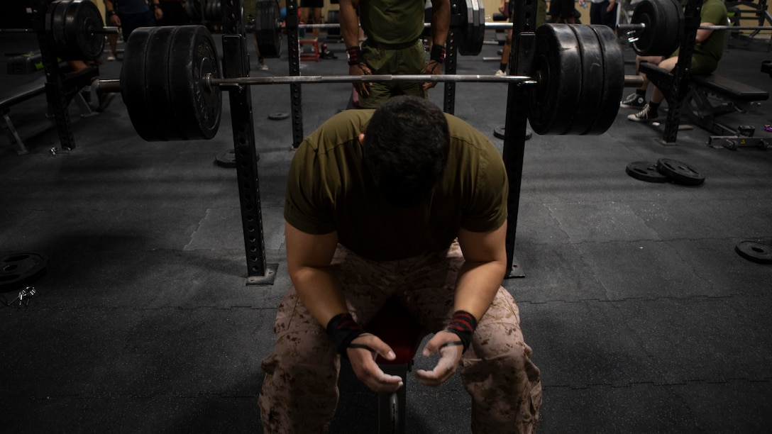 A U.S. Marine with Special Purpose Marine Air-Ground Task Force-Crisis Response-Central Command 19.2 prepares for a recorded lift during a bench press competition in Kuwait on Sept. 15, 2019. SPMAGTF-CR-CC Marines participated in a joint service chest bench press competition held on base to build comradery and test the strength of the deployed service members.