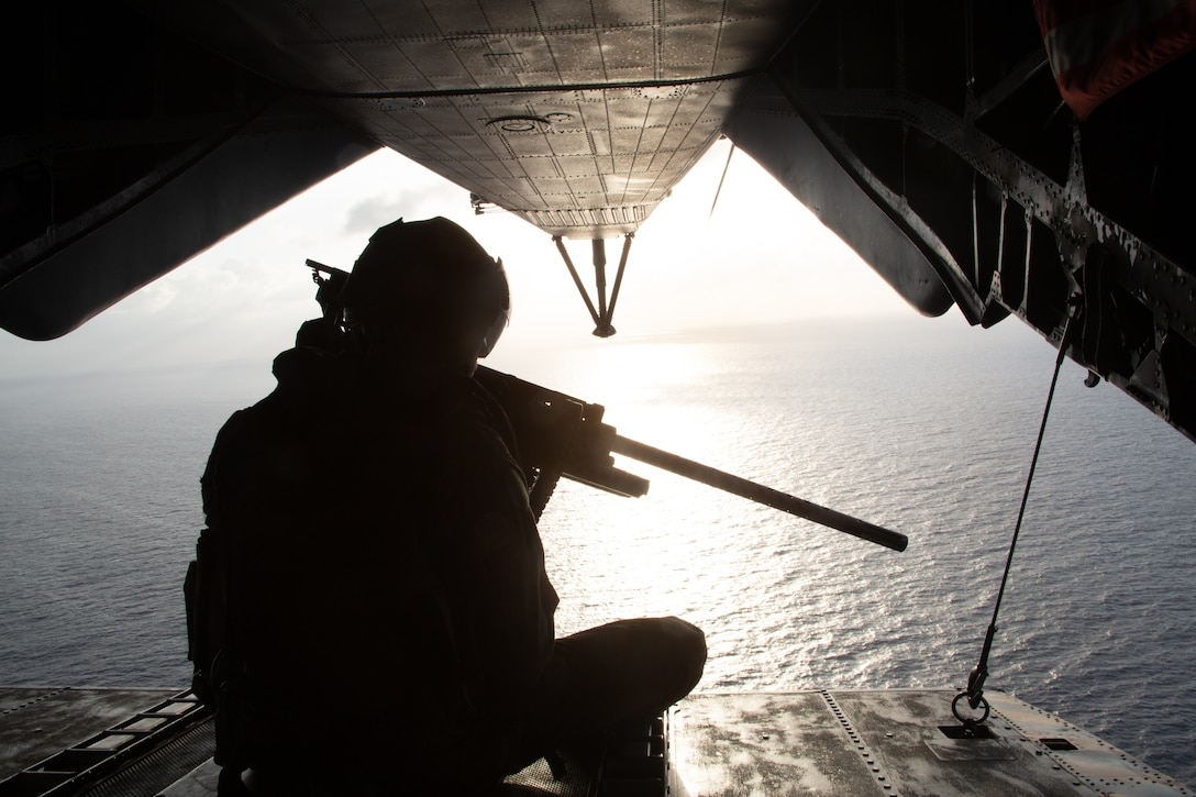 A U.S. Marine crew chief with the Special Purpose Marine Air-Ground Task Force - Southern Command mans the rear of a CH-53 during a refueling flight off the coast of Honduras, Aug. 13, 2019. The task force is conducting training and engineering projects hand-in-hand with partner nation military members in the region during their deployment that coincides with hurricane season.