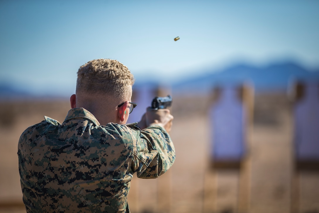 U.S. Marines with the Provost Marshals Office, Headquarters and Headquarters Squadron, Marine Corps Air Station Yuma, engage targets during a law enforcement range qualification on MCAS Yuma, Sep. 18th 2019. The LE qualification is specific to military police personnel, including several different shooting methods with both the Beretta M9 and Benelli 12 gauge shotgun.