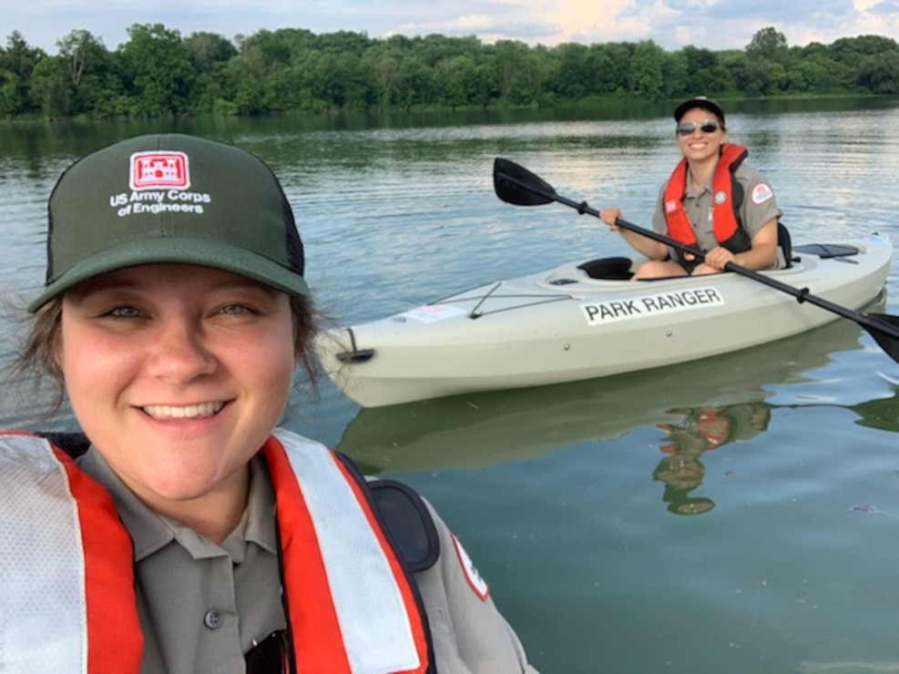 A Blue Marsh Lake Ranger takes a selfie photo with another Ranger while kayaking.