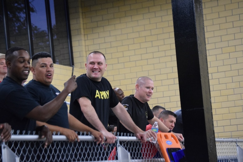 """Team members cheer on their battalion commanders during the """"Boat Wars"""" competition at Gammon Physical Fitness Center, Fort Knox, Kentucky, Sept. 22. The """"Boat War"""" was a team building exercise that leadership teams participated in during the 3rd Recruiting Brigade's three-day training forum."""