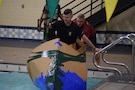 "Battalion commander pushing-off to race to the other side of the pool during the  ""Boat Wars"" competition at Gammon Physical Fitness Center, Fort Knox, Kentucky, Sept. 22. The ""Boat War"" was a team building exercise that leadership teams participated in during the 3rd Recruiting Brigade's three-day training forum."