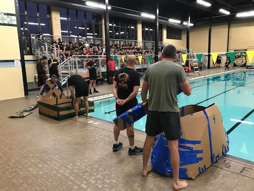 """Battalion command teams prepare to launch their boats in the pool for the """"Boat Wars"""" competition at Gammon Physical Fitness Center, Fort Knox, Kentucky, Sept. 22. The """"Boat War"""" was a team building exercise that leadership teams participated in during the 3rd Recruiting Brigade's three-day training forum."""