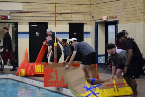 """Battalion leadership teams prepare to put their boats in the pool for the """"Boat Wars"""" competition at Gammon Physical Fitness Center here Sept. 22. The """"Boat War"""" was a team building exercise that leadership teams participated in during the 3rd Recruiting Brigade's three-day training forum."""