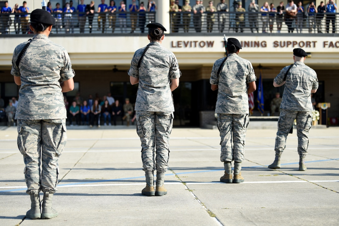 Members of the 334th Training Squadron freestyle drill team perform during the 81st Training Group drill down on the Levitow Training Support Facility drill pad at Keesler Air Force Base, Mississippi, Sept. 20, 2019. Airmen from the 81st TRG competed in a quarterly open ranks inspection, regulation drill routine and freestyle drill routine. While in training, Airmen are given the opportunity to volunteer to learn and execute drill down routines. (U.S. Air Force photo by Airman Seth Haddix)