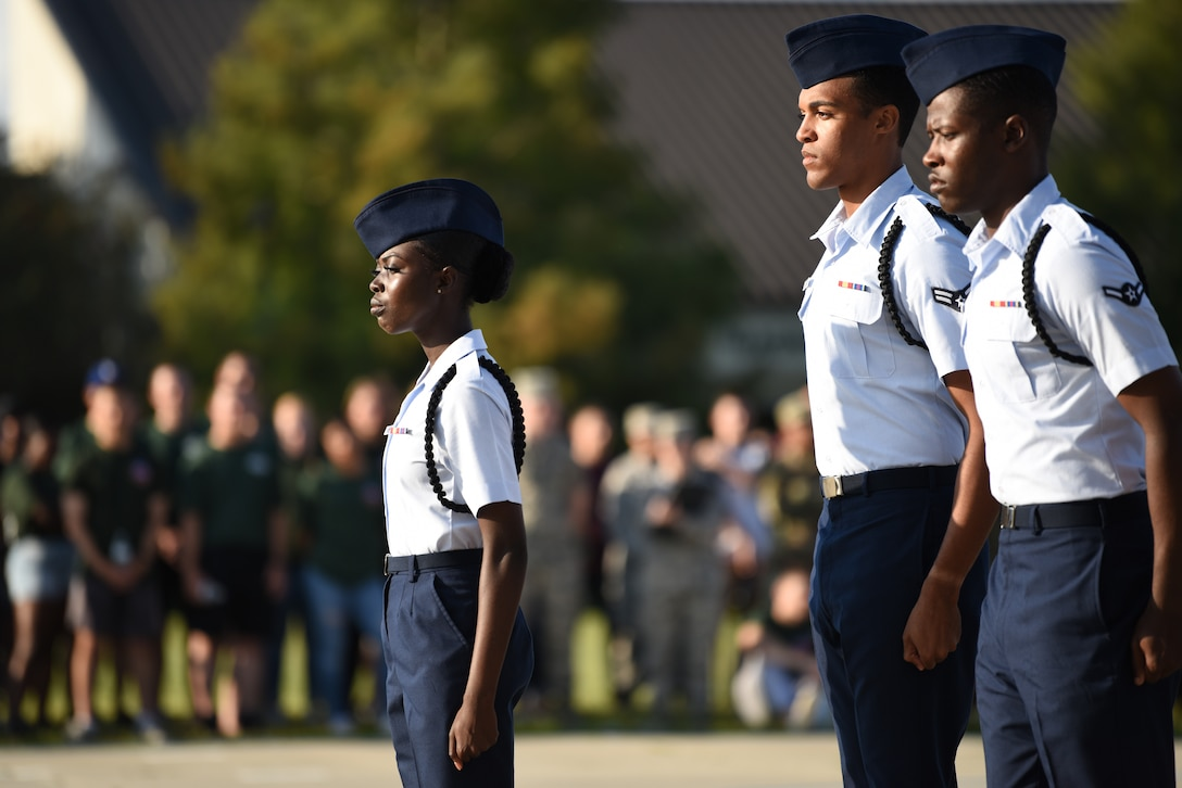 U.S. Air Force Airmen Precious Bissah, Wendell Watson III and Airman 1st Class Enrique Talley, 336th Training Squadron drill team members, perform during the 81st Training Group drill down on the Levitow Training Support Facility drill pad at Keesler Air Force Base, Mississippi, Sept. 20, 2019. Airmen from the 81st TRG competed in a quarterly open ranks inspection, regulation drill routine and freestyle drill routine. While in training, Airmen are given the opportunity to volunteer to learn and execute drill down routines. (U.S. Air Force photo by Airman Seth Haddix)