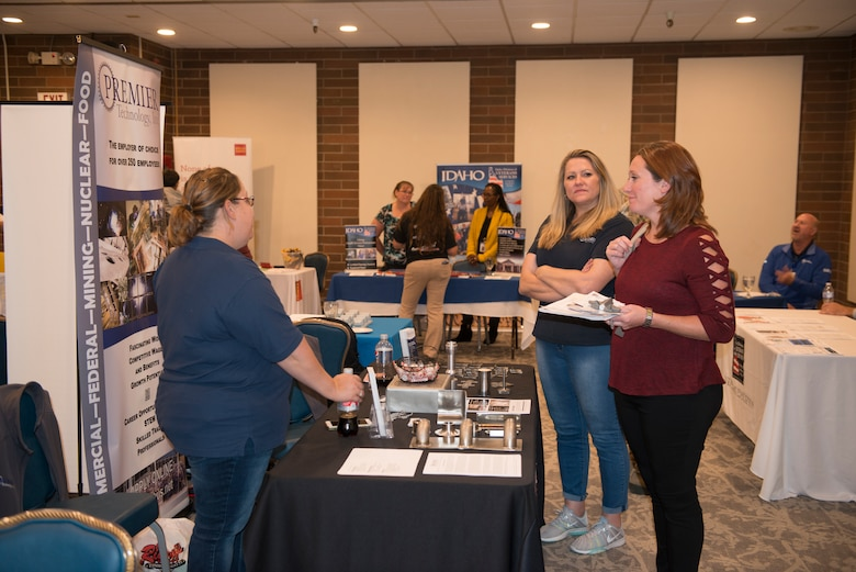 Base members attend several booths during the annual job fair event, sept 18, 2019, at Mountain Home Air Force Base, Idaho. The annual job fair was hosted to support taking care of Airmen and their families by showcasing over 57 employers. (U.S. Air Force photo by Senior Airman JaNae Capuno)