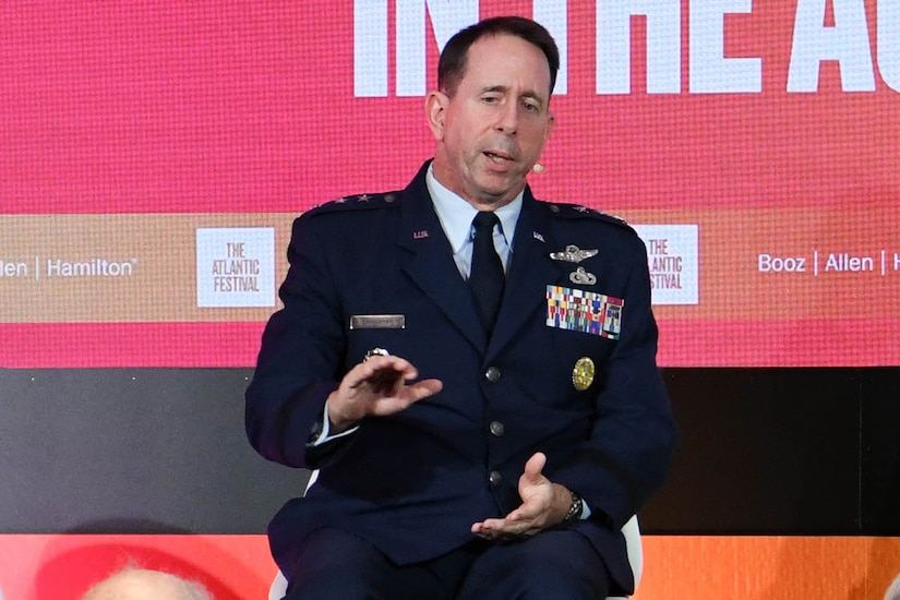 Three-star Air Force general speaks to an audience.