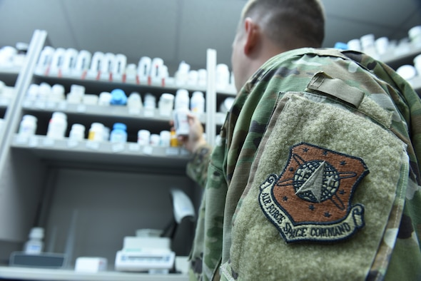 An Airman with the 21st Medical group checks a prescription at the Schriever Air Force Base, Colorado, pharmacy Sept. 11, 2019. Airmen who are part of the 21st Medical Group will become integrated with the Defense Health Agency beginning Oct. 1, which has the four-part aim of improved readiness, better health, better care and lower costs. (U.S. Air Force photo by Master Sgt. Brian Bender)