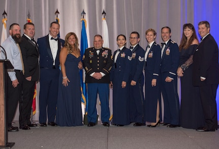 Retired Army Staff Sgt. Dan Powers, a former squad leader with the 118th military police company, stands with members of Joint Base Charleston's Red 7 and their spouses during the JB Charleston Air Force Ball, Sep. 14, 2019, in Charleston, S.C.