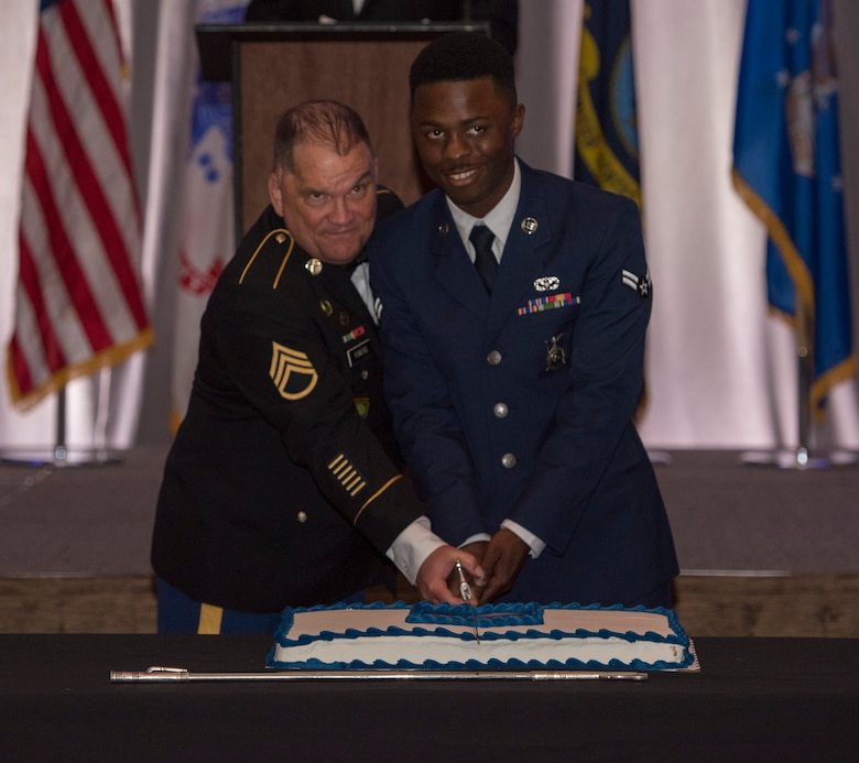 Retired Army Staff Sgt. Dan Powers, a former squad leader with the 118th military police company, and Airman 1st Class Deon Stevenson, a firefighter from the 628th Civil Engineer Squadron, cut the cake at the Joint Base Charleston Air Force ball, Sep. 14, 2019, in Charleston, S.C.