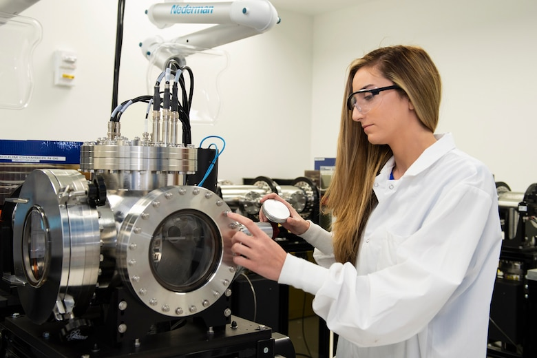Victoria Scira, a nuclear data analyst at the Air Force Technical Applications Center, Patrick AFB, Fla., examines a thermal ionization mass spectrometer in the AFTAC's Ciambrone Radiochemistry Lab.  Scira was recently hired to work at the nuclear treaty monitoring center after being selected for the Air Force Personnel Center's Science and Engineering Palace Acquire program that offers permanent full-time positions in various career fields to prospective candidates (U.S. Air Force photo by Matthew S. Jurgens)