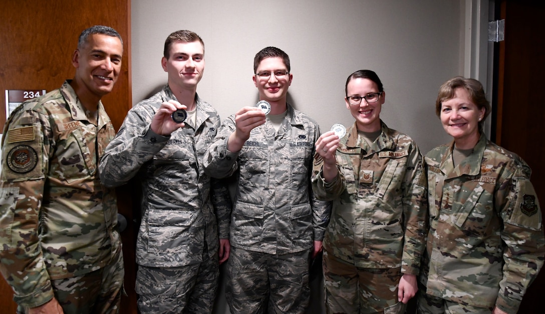 AMC commander presents coins to top performers
