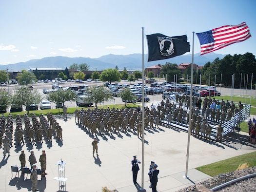 The High Frontier Honor Guard prepares to lower the Prisoner of War/Missing in Action flag Sept. 20, 2019, at Peterson Air Force Base, Colorado, during a retreat ceremony at the end of POW/MIA Remembrance Week. The week honors American service members who were captured overseas and all unreturned veterans. (U.S. Air Force photo by Griffin Swartzell)