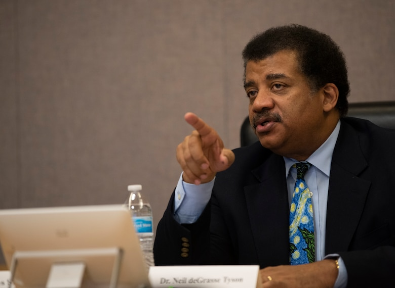 Neil deGrasse Tyson, astrophysicist and author, discusses the nuances of the 2nd Space Operations Squadron GPS satellite constellation with wing leadership during a mission brief at Schriever Air Force Base, Colorado, Sept. 23, 2019. The 2nd SOPS GPS satellite constellation supports more than six-billion users globally. (U.S. Air Force photo by Airman 1st Class Jonathan Whitely)