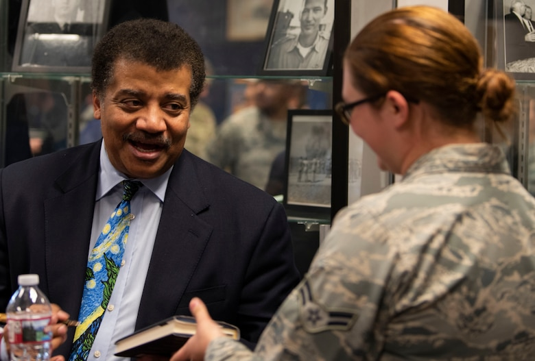 Neil deGrasse Tyson, astrophysicist and author, signs a book for an Airman at Schriever Air Force Base, Colorado, Sept. 23, 2019. At the end of his visit to learn more about Schriever Air Force Base, Tyson took time to engage with Airmen. (U.S. Air Force photo by Airman 1st Class Jonathan Whitely)