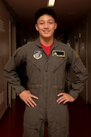 Joey DeGrella, Yokota High School senior and Junior Reserve Officer Training Corps. class commander, poses for a photo after changing into a flight suit with his very own name tapes during the 36th Airlift Squadron's Pilot for a Day program, Sept. 20, 2019, at Yokota Air Base, Japan.