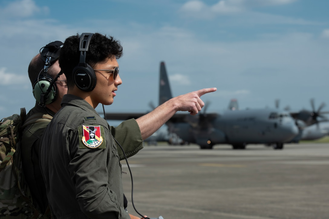 Joey DeGrella, Yokota High School senior and Junior Reserve Officer Training Corps. class commander, watches from afar as the pre-flight checklist is completed for the C-130J Super Hercules that he will fly on as part of the 36th Airlift Squadron's Pilot for a Day program, Sept. 20, 2019, at Yokota Air Base, Japan.