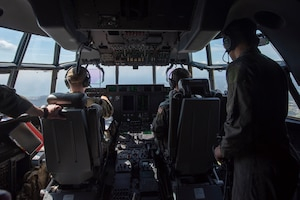 Aircrew of a C-130J Super Hercules assigned to the 36th Airlift Squadron and Joey DeGrella, Pilot for a Day program participant, fly over the Chubu region, Japan, Sept. 20, 2019.