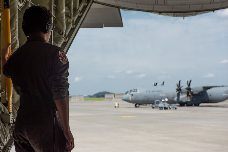 Joey DeGrella, Yokota High School senior and Junior Reserve Officer Training Corps. class commander, looks out over the flightline after a C-130J Super Hercules flight during the 36th Airlift Squadron's Pilot for a Day program, Sept. 20, 2019, at Yokota Air Base, Japan.