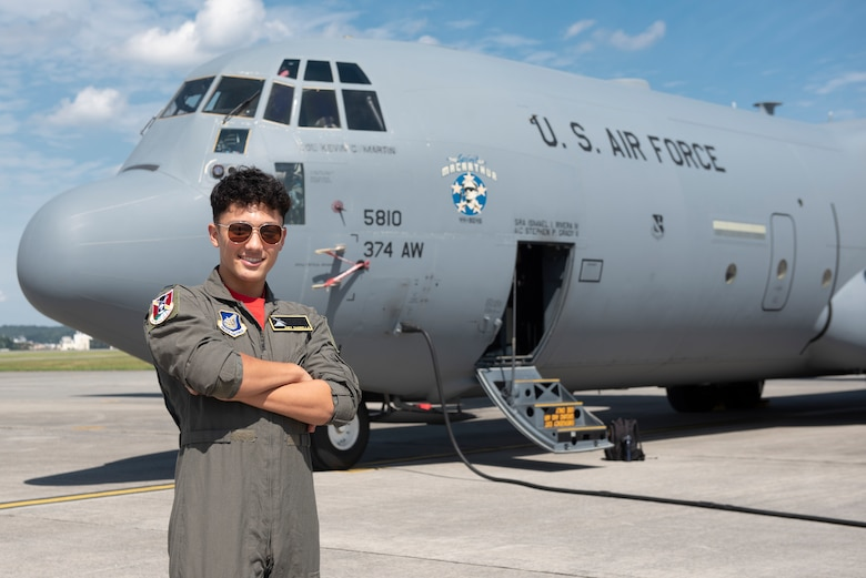 Joey DeGrella, Yokota High School senior and Junior Reserve Officer Training Corps. class commander, poses for a photo in front of a C-130J Super Hercules during the 36th Airlift Squadron's Pilot for a Day program, Sept. 20, 2019, at Yokota Air Base, Japan