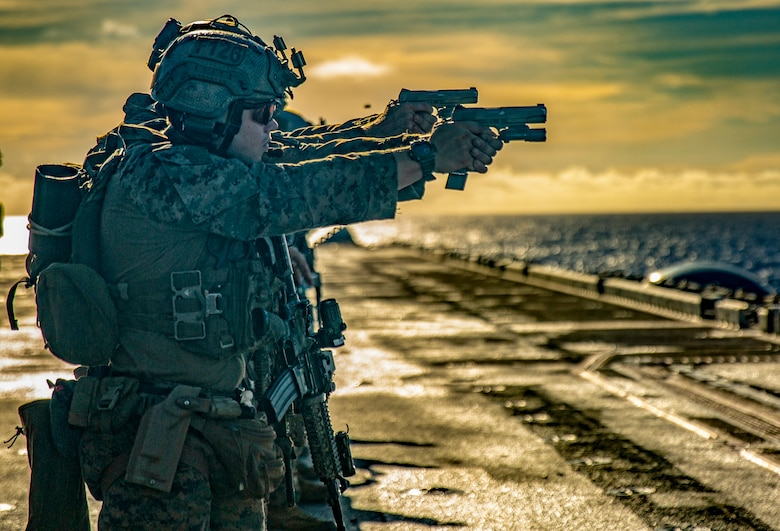 Marines pefrom live fire exercise.