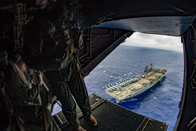 Marines fly over USS Boxer.
