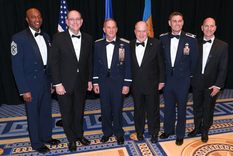 Chief Master Sergeant of the Air Force Kaleth O. Wright, Acting Secretary of the Air Force Matthew P. Donovan, Chief of Staff of the Air Force Gen. David L. Goldfein, Air Force Association Chairman of the Board F. Whitten Peters, Col. Stephen Sanders, Air Force JROTC director, and Todd Taylor, Air Force JROTC chief of program development, pose before the Air Force Birthday Dinner in National Harbor, Maryland, Sept. 18, 2019. Peters presented Air Force JROTC with the AFA Chairman's Award for Aerospace Education Achievement to recognize the work of 120,000 cadets, more than 1,900 instructors and headquarters staff on promoting and advocating aerospace education and science, technology, engineering and math programs.