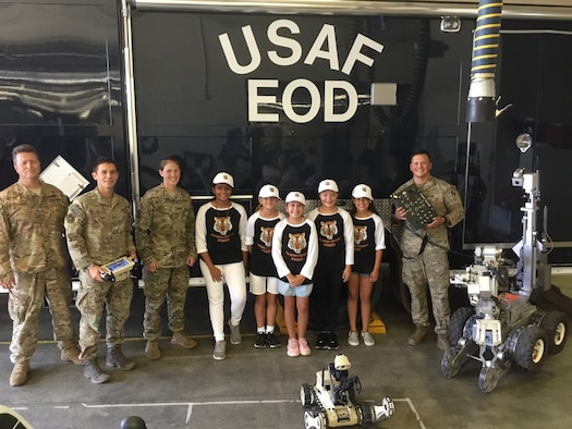 EOD Airmen pose with the Techno Tigresses.