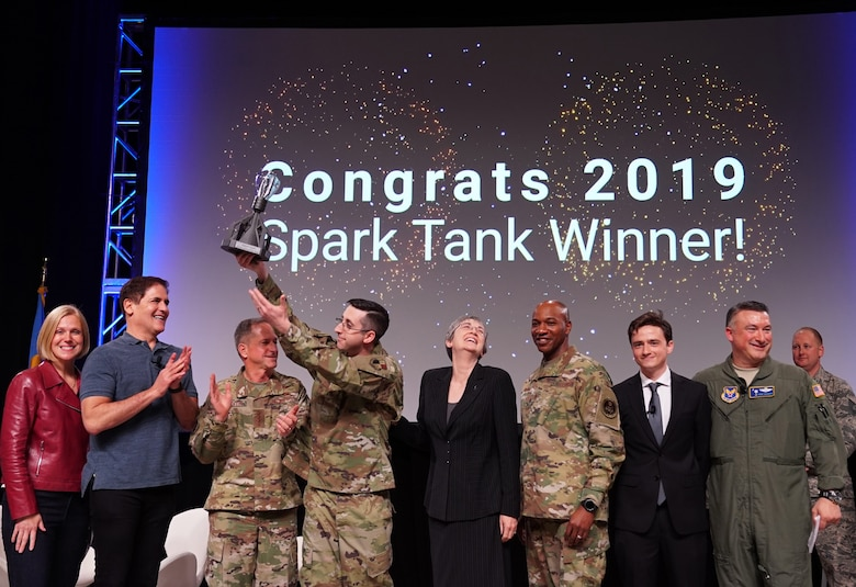 The 2019 Air Force Spark Tank competition judges congratulate Master Sgt. Jonathan Maas