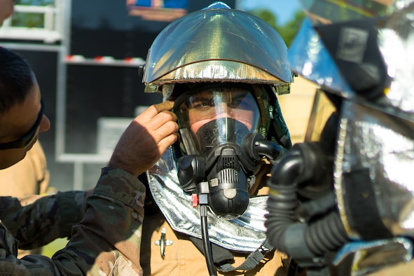 A firefighter prepares to enter a fire simulation building during Patriot Warrior 2019