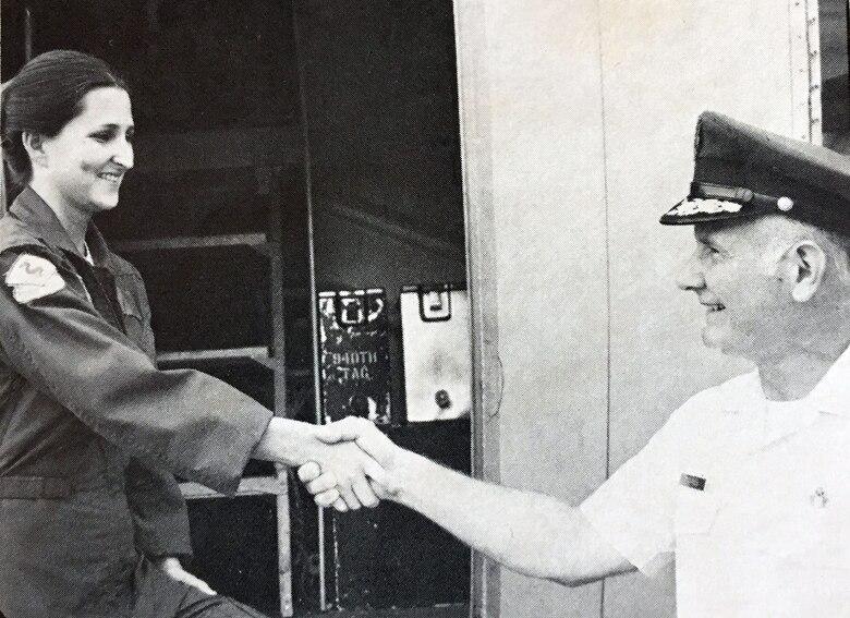 Maj. Gen. Sidney Novaresi, then-4th Air Force commander, congratulates Staff Sgt. Wanda Busby.