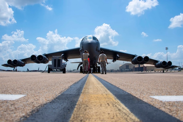 Crew chiefs from the 11th Aircraft Maintenance Unit run final checks