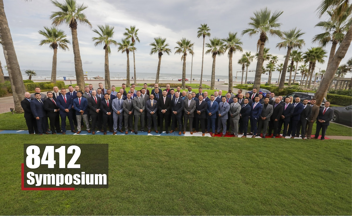 Career recruiters with the 8th Marine Corps District pose for a group photo during the 8412 Symposium at the Hotel Galvez and Spa in Galveston, Texas, Aug. 28, 2019. The 8412 Symposium provides a forum for Career Recruiters across the 8th Marine Corps District to collaborate, review recruiting doctrine, and discuss ways to support the Marine Corps recruiters.