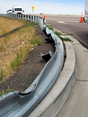 Crashes remain a possibility at the Peterson Air Force Base, Colorado east gate intersection with Marksheffel Road, where a recent collision damaged the guard rail along the right turn lane, pictured Sept. 23, 2019. Thanks to a partnership between Peterson's 21st Civil Engineer Squadron and the city of Colorado Springs, construction has begun on a proper traffic signal for the intersection, which should be complete by late October. (Air Force photo by Griffin Swartzell)