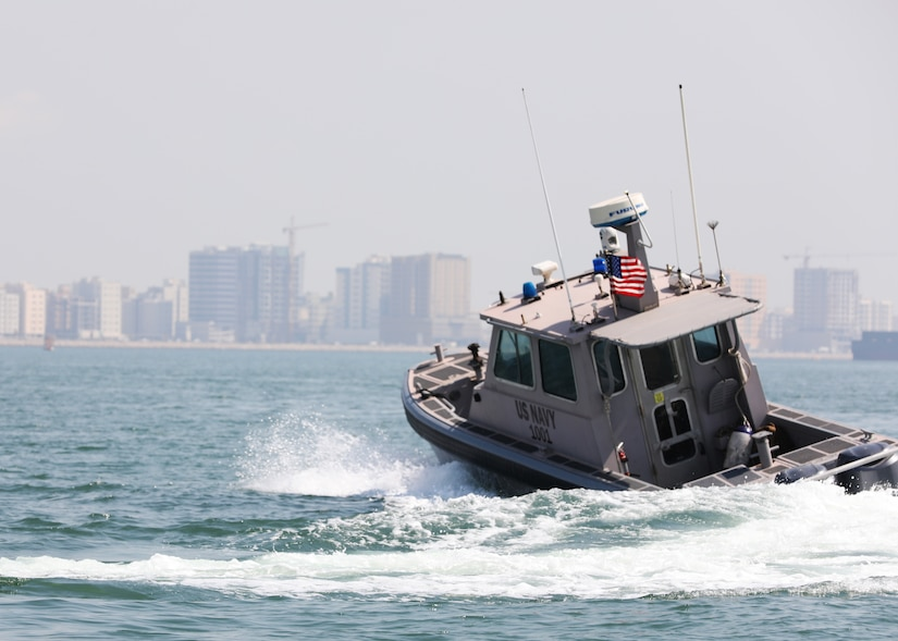 Sailors assigned to Task Force Shore Battle Space pursue a Bahraini Coast Guard security boat during exercise Neon Defender 19. Exercise Neon Defender 19 is a bilateral surface and maritime security exercise between the U.S. Navy and Bahrain Defense Force to enhance interoperability and war fighting readiness, fortify military- to- military relationships between the United States and the Kingdom of Bahrain, advance mutual operational capabilities and strengthen civil-to-military relationships. (U.S. Army Photo by Spc. Eric Cerami/Released)
