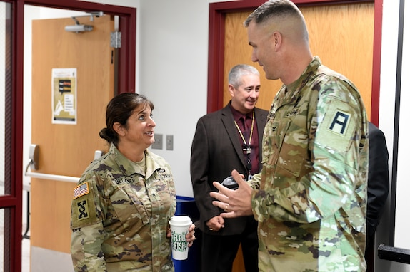 Brig. Gen. Kris A Belanger, Commanding General, 85th U.S. Army Support Command talks with Col. David Woodruff, 181st Infantry Brigade (MFTB) Commander, Fort McCoy, Wisconsin, during the New Brigade Command Teams training, September 21-22, 2019.