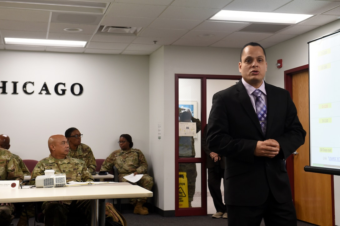 Paul O'Connell, G-3 Staff Operations and Training Specialist, 85th U.S. Army Reserve Support Command, talks about mission planning during the New Command Teams training brief, September 21-22, 2019.