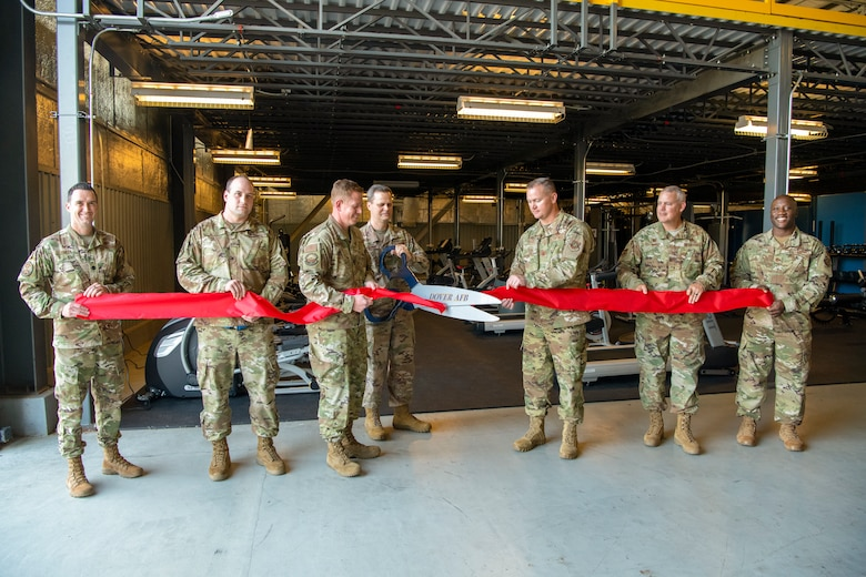 Col. Joel Safranek, 436th Airlift Wing commander, cuts a ribbon during a ceremony unveiling the new maintenance squadron gym Sept. 10, 2019, at Dover Air Force Base, Del. The gym was assembled in two days and cost approximately $80,000. (U.S. Air Force photo by Senior Airman Christopher Quail)