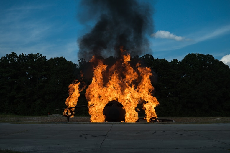 A training fuselage is engulfed in flames during Patriot Warrior 2019 at Dobbins Air Reserve Base, Georgia.