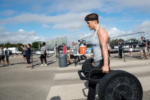 Second Lt. Michelle Strickland, 37th Flying Training Squadron student pilot, walks with weights for the farmer walk obstacle, Sept. 14, 2019, at Retama Park in Selma, Texas. Alpha warrior hosts battle competition where branches of the military can compete for fastest time. (Courtesy photo)