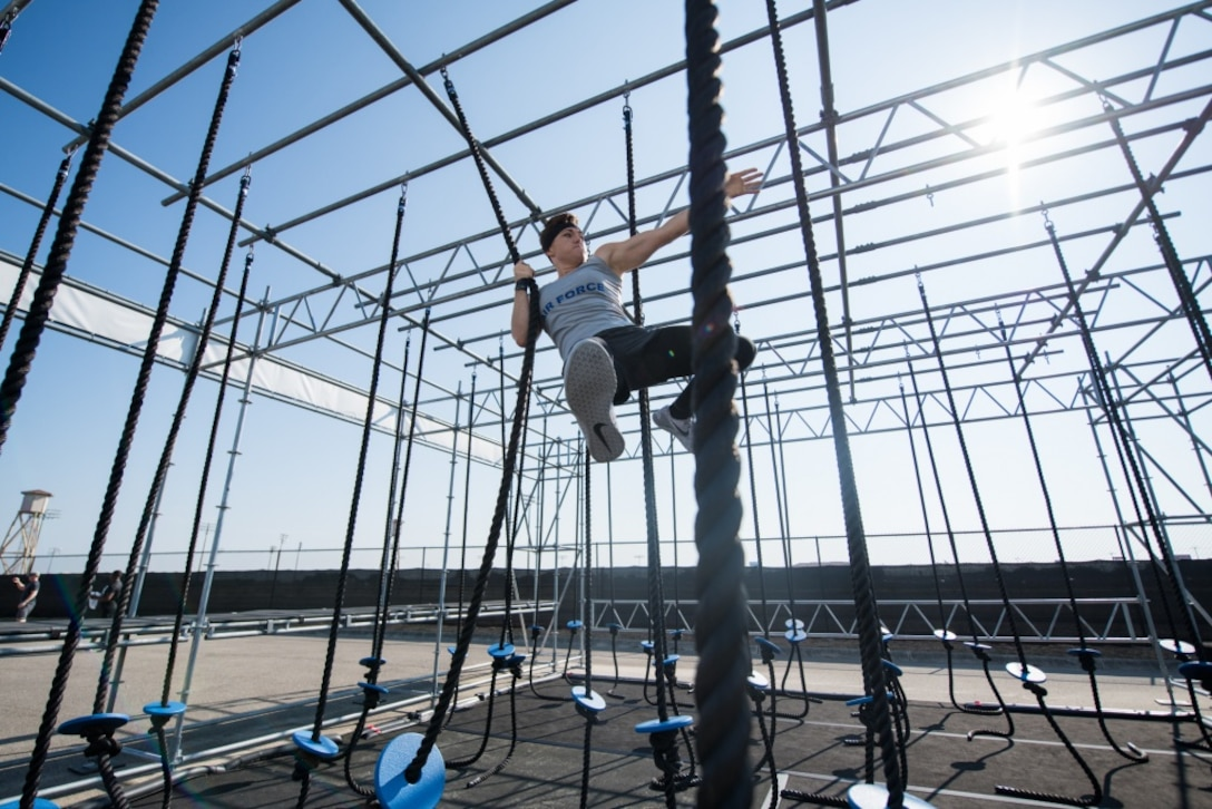 Second Lt. Michelle Strickland, 37th Flying Training Squadron student pilot, swings across a rope obstacle course during the Alpha Warrior Inter-Service Championship, Sept. 14, 2019, at Retama Park in Selma, Texas. The Alpha Warrior course consisted of more than 30 obstacles where the Air Force team battled and raced across the course for best time. (Courtesy photo)