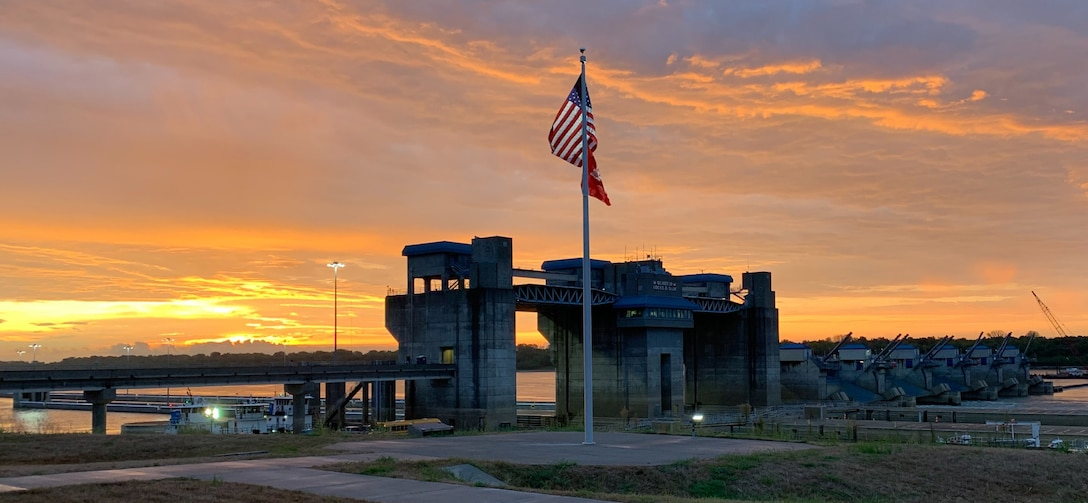 The sun rises over Olmsted Locks and Dam in  Olmsted, Illinois