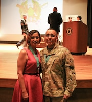 1st Sgt. Paul D. Gomez, first sergeant, Headquarters and Headquarters Company, Special Troops Battalion, 1st Theater Sustainment Command (TSC) and his wife, Jennifer, attend the Sergeant Audie Murphy induction/Margaret C. Corbin award ceremony on Fort Knox, Ky., May 30, 2019. Jennifer Gomez received the Margaret C. Corbin award for her volunteerism.