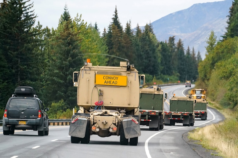 Soldiers assigned to the 109th Transportation Company, 17th Combat Support Sustainment Battalion, U.S. Army Alaska, convoy through the Kenai Penninsula to load U.S. Marine Corps bulk fuel supplies and equipment from the U.S.S. Comstock (LSD-45), a Whidbey Island-class dock landing ship, at the port of Seward, Alaska, Sept. 19, 2019, for transport to Joint Base Elmendorf-Richardson, Alaska. The U.S. Navy is conducting an Arctic Expeditionary Capabilities Exercise to test its logistical effectiveness and joint-service interoperability while responding to conflict or disaster in an austere environment with no organic assets.